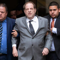 Harvey Weinstein, center, leaves court following a bail hearing, December 6, 2019 in New York. (AP Photo/Mark Lennihan)