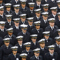 Navy midshipmen march ahead of an NCAA college football game between the Army and the Navy, December 14, 2019, in Philadelphia. (AP Photo/Matt Rourke)