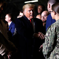 US President Donald Trump after signing the National Defense Authorization Act for Fiscal Year 2020 at Andrews Air Force Base, Maryland, December 20, 2019. (AP Photo/Andrew Harnik)
