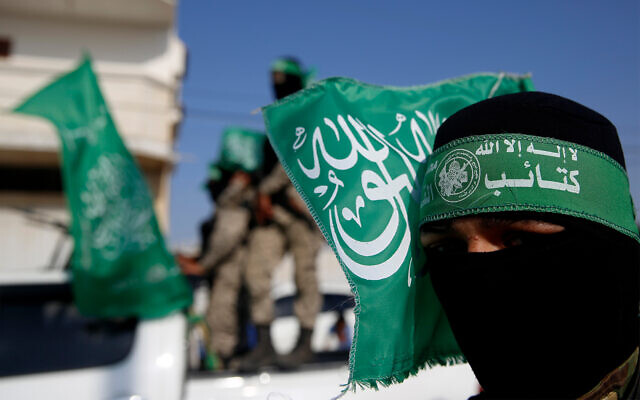 Hamas terrorists march in Khan Younis, southern Gaza Strip, November 11, 2019. (AP Photo/Hatem Moussa)