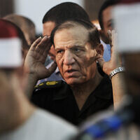 Then Egyptian armed forces Chief of Staff Sami Annan prays for 16 Egyptian soldiers who were killed, in Cairo, Egypt, August 5, 2012. (AP Photo/Amr Nabil, File)
