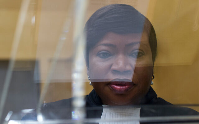 ICC prosecutor Fatou Bensouda is seen through a plexiglass lectern in the court room of the International Criminal Court, in The Hague, Netherlands, September 29, 2015. (AP Photo/Peter Dejong, Pool)