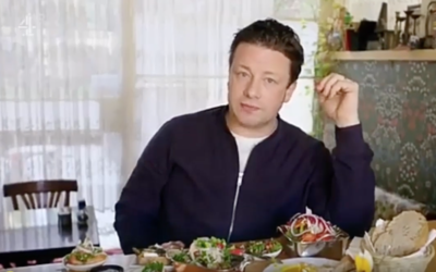 Naked chef Jamie Oliver dining on a sumptuous breakfast at Jerusalem cafe Kalo (Courtesy Youtube screen grab)