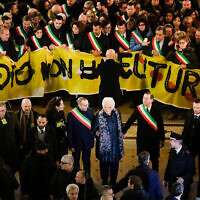 Liliana Segre, an 89-year-old Auschwitz survivor and senator-for-life, center, attends an anti-racism demonstration in Milan's Victor Emmanuel II arcade in northern Italy joined by mayors of some 600 Italian towns, December 10, 2019. (AP Photo/Luca Bruno)