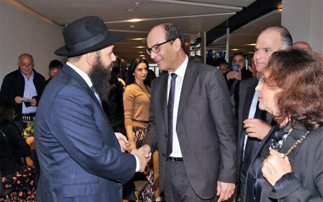 Rabbi Levi Banon greets Moroccan official Said Ahmidouch and his wife at a Hannukah celebration in Casablanca, Morocco, December 22, 2019. (Courtesy/Chabad.org)