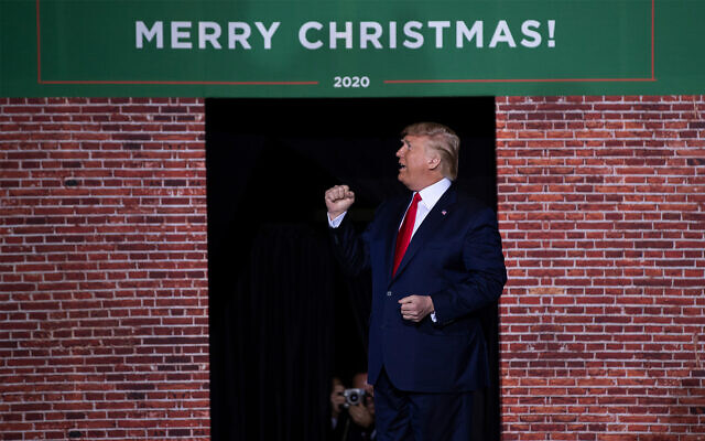 US President Donald Trump speaks during a campaign rally at Kellogg Arena, Wednesday, Dec. 18, 2019, in Battle Creek, Michigan. (AP Photo/ Evan Vucci)