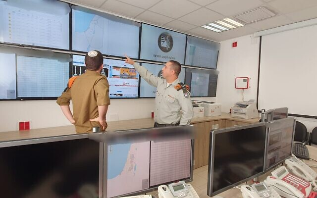 Illustrative: Soldiers from the IDF Home Front Command work in a command center used to oversee the country's alert system in an undated photograph. (Israel Defense Forces)