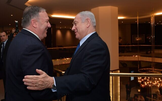 US Secretary of State Mike Pompeo, left, and Prime Minister Benjamin Netanyahu meet in Lisbon, Portugal, December 4, 2019. (Kobi Gideon/GPO)