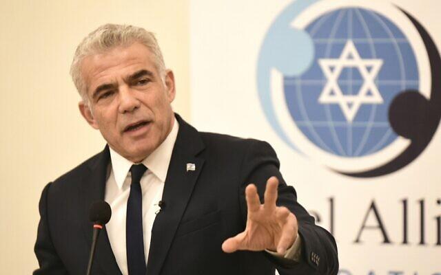 MK Yair Lapid addressing the Israel Allies Foundations conference in Jerusalem, December 9, 2019 (Avi Hayun)