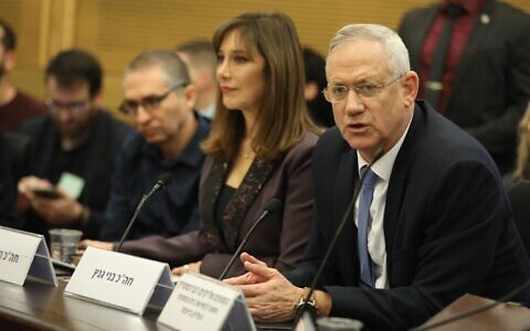 Blue and White chairman Benny Gantz (R) speaking at Knesset conference organized by Labor-Gesher MK Revital Swid (C) on 'protecting the rule of law,' December 11, 2019. (Elad Malka/Blue and White)