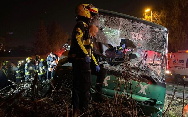 Emergency services at the site of a deadly bus crash on Highway 40 near Ben Gurion Airport, December 22, 2019. (Magen David Adom)