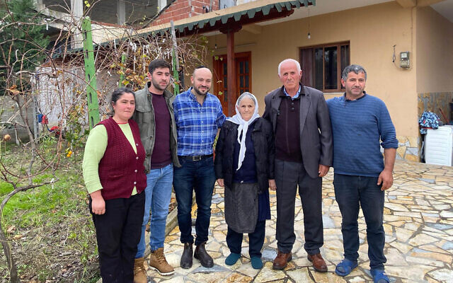 Jonny Daniels, third from left, with the Bicaku family in their home in Durres, Albania, Dec. 11, 2019. (Courtesy of From the Depths)