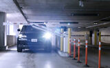 A car exiting a parking lot; Arrive and Israel R&D team seek to find better parking solutions for users (Courtesy)