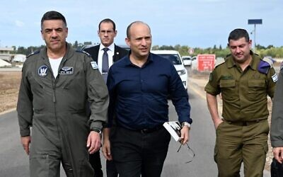 Defense Minister Naftali Bennett, center, and Air Force commander Maj. Gen. Amikam Norkin, left, during a visit to the Hatzor Air Force Base on December 3, 2019. (Twitter screen capture)