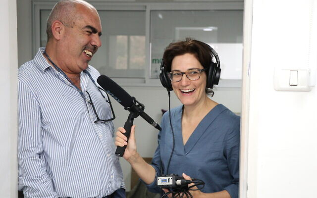 Dina Kraft interviewing Sami Saadi, co-CEO of Tsofen, in Nazareth, November 2019, for the 15th episode of her Hadassah podcast, 'The Branch.' (Courtesy Mitchell Coopersmith)