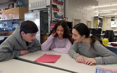 Students in an eighth-grade Hebrew class at Alan B. Shepard Middle School in Deerfield, Illinois, write a Hebrew screenplay together, December 13, 2019. (Ben Sales/JTA)