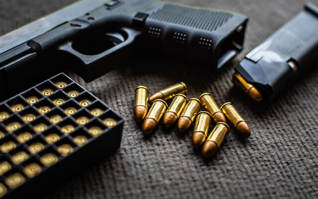 Illustrative: A handgun and bullets (Somboon Kaeoboonsong; iStock by Getty Images)