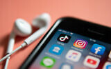 ILLUSTRATIVE- An iPhone loaded with TikTok and other social media application icons. (Wachiwit/iStock)