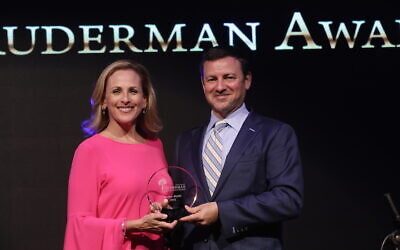 Jay Ruderman presents Marlee Matlin, an Oscar-winning actress who is deaf and Jewish, with the Morton E. Ruderman Award in Tel Aviv, June 19, 2017. (Erez Uzir via JTA)