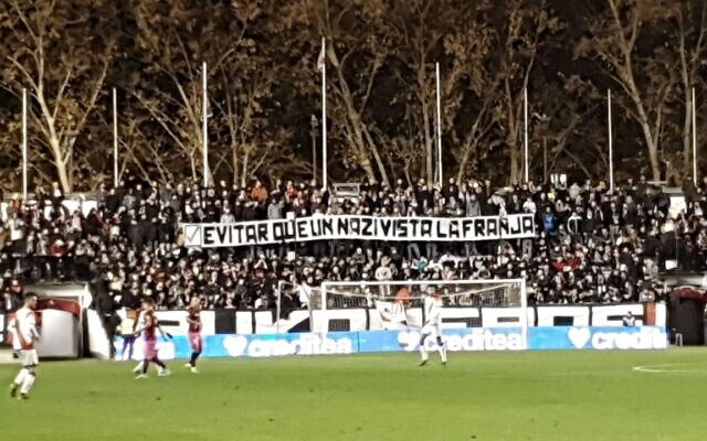 Fans hold up a sign accusing Ukrainian player Roman Zozulia of being a  Nazi in Spain on December 15, 2019 ( Twitter)