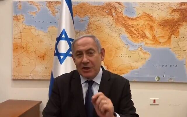 Prime Minister Benjamin Netanyahu seen in a video produced on December 22, 2019, by his office in which he criticizes the High Court of Justice for considering a petition to declare him ineligible to run for re-election over pending corruption indictments. (Twitter screen capture)