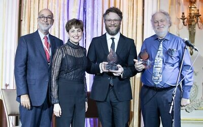 From left: Rich Rumelt, the board president of The Workers Circle; Ann Toback, the group's executive director; Seth Rogen; and Mark Rogen at the organization's ceremony in New York City, Dec. 2, 2019. (Mark Stephen Kornbluth via JTA)