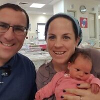 Tzippi Rimel (R) with her husband Ephraim and three-week-old daughter Noam. (Courtesy)