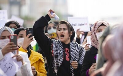 Illustrative: An Iraqi student shouts slogans during an anti-government demonstration in the southern city of Basra on December 31, 2019. (Hussein Faleh/AFP)
