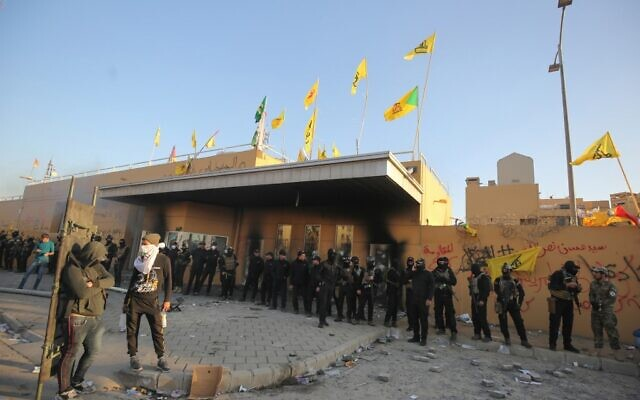 Iraqi security forces stand guard at the entrance of US embassy in the capital Baghdad after supporters and members of the Popular Mobilization Force militia breached the outer wall of the compound during a rally to vent anger over weekend air strikes that killed pro-Iran fighters in western Iraq, on December 31, 2019. (AHMAD AL-RUBAYE/AFP)