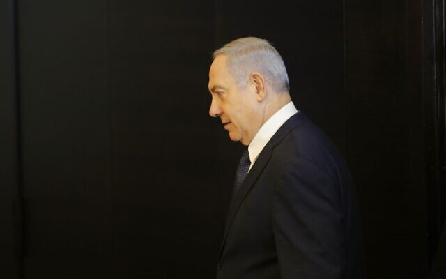 Prime Minister Benjamin Netanyahu arrives to deliver a statement regarding his intention to file a request to the Knesset for immunity from prosecution, in Jerusalem on January 1, 2020. (Gil Cohen-Magen/AFP)
