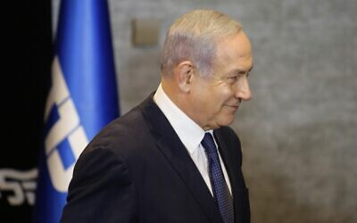 Prime Minister Benjamin Netanyahu leaves a press conference in Jerusalem after announcing his intention to file a request with the Knesset for immunity from prosecution, January 1, 2020. (Gil Cohen-Magen/AFP)