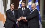Prime Minister Benjamin Netanyahu (R), his Greek counterpart Kyriakos Mitsotakis (C) and Cypriot President Nikos Anastasiadis shake hands in Athens on January 2, 2020, ahead of the signing of an agreement for the EastMed pipeline project designed to ship gas from the eastern Mediterranean to Europe. (Aris Messins/AFP)