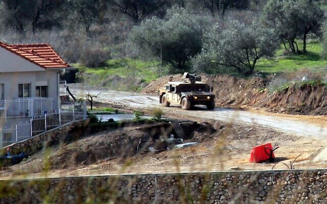 A picture taken from the southern Lebanese border town of Kfar Kila shows an Israeli military vehicle in Metullah on the Israeli side on January 3, 2020. (Ali Dia/AFP)