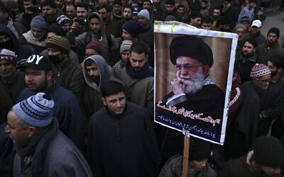A protester holds a poster with an image of Iranian leader Ayatollah Ali Khamenei during a demonstration against the United States following a US airstrike in Iraq that killed top Iranian commander Qassem Soleimani, in the Kashmiri town of Magam on January 3, 2020. (Tauseef MUSTAFA/AFP)