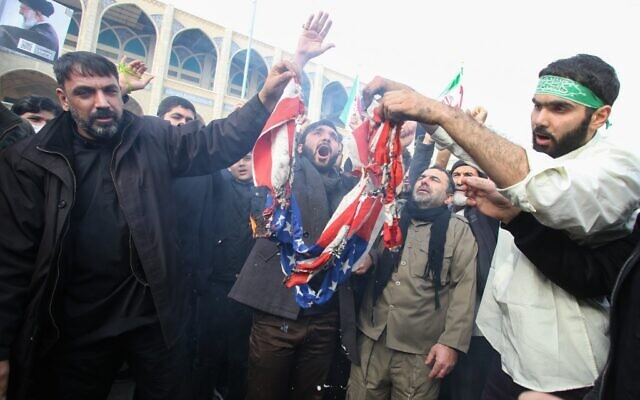 Iranians burn a US flag during a demonstration in Tehran on January 3, 2020, following the killing of Quds Force General Qassem Soleimani in a US strike on his convoy at Baghdad international airport. (Atta Kenare/AFP)