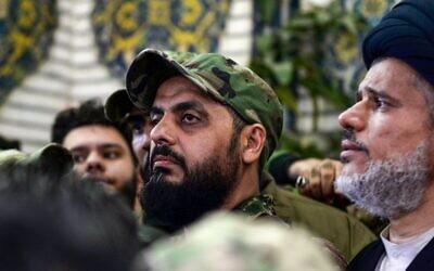 Qais al-Khazali (C) commander of the Asaib Ahl al-Haq pro-Iran faction attends the funeral procession of slain Iraqi paramilitary chief Abu Mahdi al-Muhandis, Iranian military commander Qasem Soleimani and eight others at the Imam Ali Shrine in the shrine city of Najaf in central Iraq, January 4, 2020. (Haidar HAMDANI/AFP)