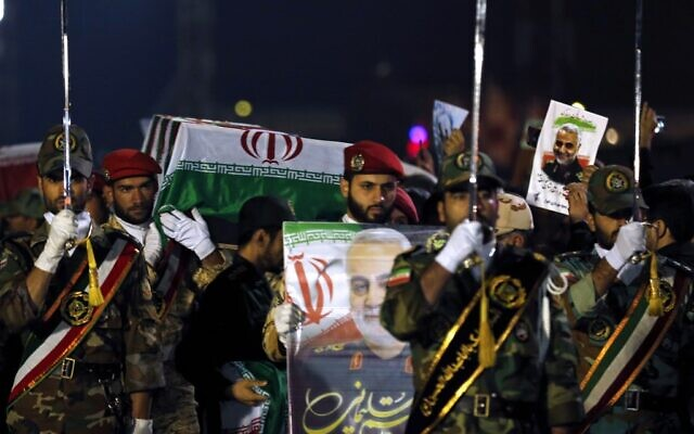 Military personnel carry the casket of Iranian commander Qassem Soleimani upon arrival at Ahvaz International Airport in Iran on January 5, 2020. (HOSSEIN MERSADI/Fars News/AFP)
