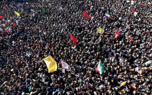 Iranian mourners gather during the final stage of funeral processions for slain top general Qassem Soleimani, in his hometown Kerman on January 7, 2020 (ATTA KENARE / AFP)