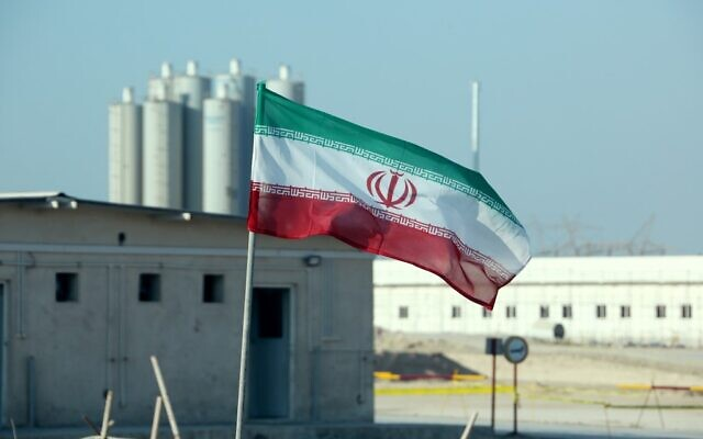 An Iranian flag flutters at Iran's Bushehr nuclear power plant on November 10, 2019. (Atta Kenare/AFP)