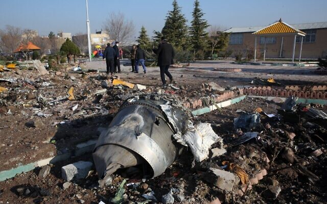 Rescue teams work amidst debris after a Ukrainian plane carrying 176 passengers crashed near Imam Khomeini airport in the Iranian capital Tehran early in the morning on January 8, 2020, killing everyone on board. (AFP)