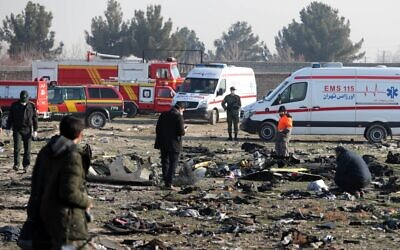 Rescue teams work amid debris after a Ukrainian plane carrying 176 passengers crashed near Imam Khomeini airport in the Iranian capital Tehran on January 8, 2020, killing everyone on board. (AFP)