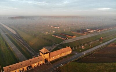 This photograph taken on December 15, 2019, in Oswiecim, Poland, shows an aerial view of the railway entrance to former German Nazi death camp Auschwitz II - Birkenau with its SS guards tower. (Pablo GONZALEZ / AFP)