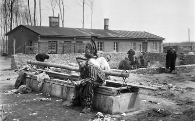 In this photograph taken in April 1945, survivors of the Buchenwald Nazi concentration camp sit on a latrine, after the liberation of the camp by Allied troops. (Eric Schwab/AFP)