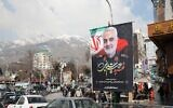 Iranians walk past a poster of slain military commander Qassem Soleimani off a main square in the Islamic Republic's capital Tehran on January 11, 2020. (Atta Kenare/AFP)