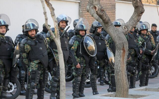 Iranian security forces stand guard in front of the British embassy in the capital Tehran on January 12, 2020 during demonstrations following the British ambassador's arrest for allegedly attending an illegal demonstration. (ATTA KENARE / AFP)