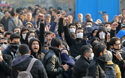Iranian students gather for a demonstration over the downing of a Ukrainian airliner at Tehran University on January 14, 2020. (ATTA KENARE / AFP)