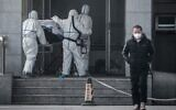 Medical staff members carrying a patient into the Jinyintan hospital, where patients infected by a mysterious SARS-like virus are being treated, in Wuhan in China's central Hubei province, January 18, 2020. (AFP)
