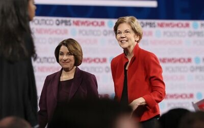 In this file photo taken on December 19, 2019, Democratic presidential candidate Senator Elizabeth Warren (D-MA) (R) and Senator Amy Klobuchar (D-MN)) walk on the stage after the Democratic presidential primary debate at Loyola Marymount University in Los Angeles, California (JUSTIN SULLIVAN / GETTY IMAGES NORTH AMERICA / AFP)