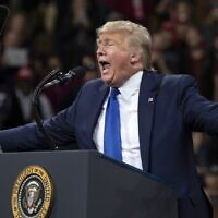 US President Donald Trump gestures as he speaks during a 'Keep America Great' campaign rally in Milwaukee, Wisconsin, on January 14, 2020. (SAUL LOEB / AFP)