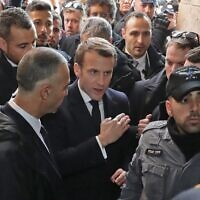 French President Emmanuel Macron asks Israeli police to leave the 12th-century Church of Saint Anne in the Old City of Jerusalem on January 22, 2020. (Ludovic Marin/AFP)